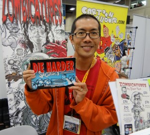 Stan Yan holds the printed version of Subculture at Comic-Con in 2012 in front of a zombie poster