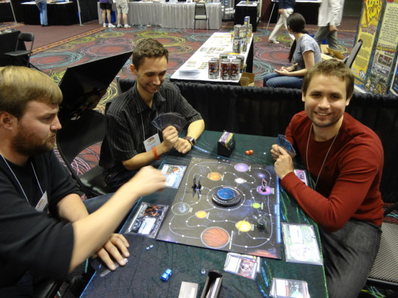 Three players trying new board game Chaosmos