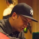 New York Yankees ball cap on Jake Williams head as he plays Heroclix
