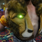 Closeup detail of Kraven the Hunter cosplay jacket with lightup eyes