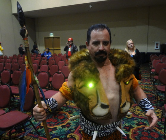 Buck Steele cosplaying as Kraven the Hunter complete with Spear and Glowing Lion Eyes
