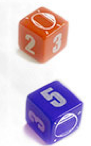 Two dice, one red one blue with numbers on them and a circular mirror for Chaosmos board game